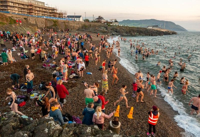 people on greystones beach